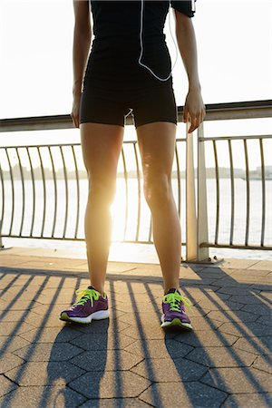 spring - Young female jogger taking a break at sunrise Stock Photo - Premium Royalty-Free, Code: 614-07146065