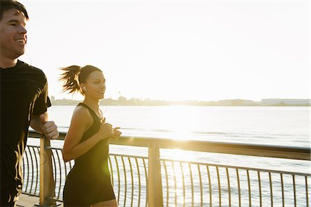 exercising - Jogging couple running along riverside early morning Stock Photo - Premium Royalty-Free, Code: 614-07146067