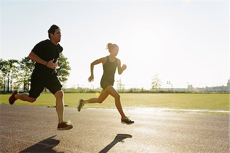 Couple running in city park early morning Stock Photo - Premium Royalty-Free, Code: 614-07146074