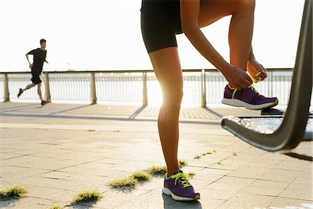 spring - Young female jogger fastening laces Stock Photo - Premium Royalty-Free, Code: 614-07146071