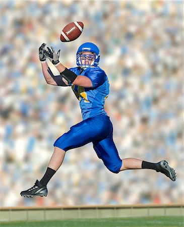 American footballer catching ball Stock Photo - Premium Royalty-Free, Code: 614-07146105