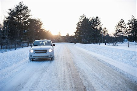 extreme terrain - Car driving along road in snow Stock Photo - Premium Royalty-Free, Code: 614-07146158