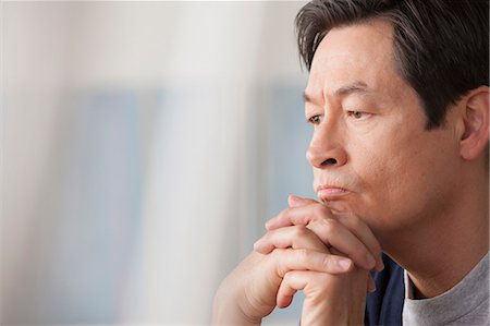 portrait looking away - Mature man with hands on chin Stock Photo - Premium Royalty-Free, Code: 614-07146171