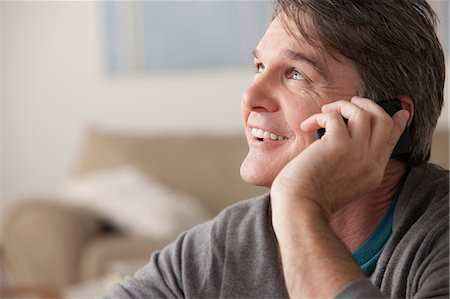 Mature man on cell phone Stock Photo - Premium Royalty-Free, Code: 614-07146187
