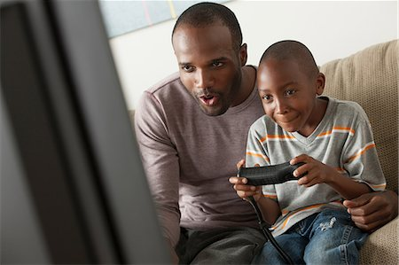 father with two sons not girls - Father and son playing video game Stock Photo - Premium Royalty-Free, Code: 614-07146247