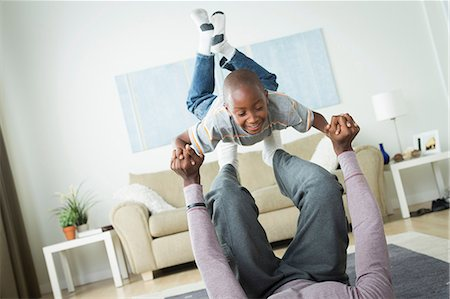 Father lifting son on feet Stock Photo - Premium Royalty-Free, Code: 614-07146268
