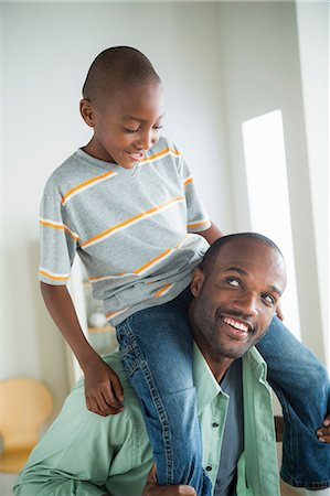 Father giving son piggy back Stock Photo - Premium Royalty-Free, Code: 614-07146289