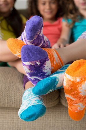 Girls wearing brightly coloured socks Stock Photo - Premium Royalty-Free, Code: 614-07146294