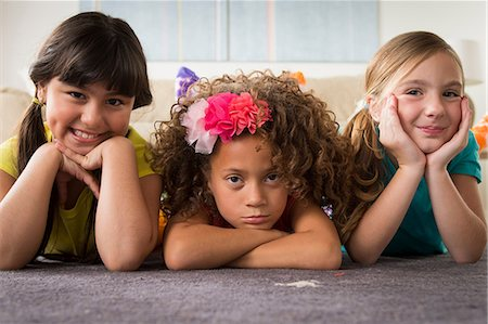 sad girls - Portrait of three girls lying on front Stock Photo - Premium Royalty-Free, Code: 614-07146296
