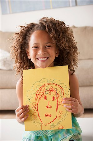 draw - Girl holding a drawing Stock Photo - Premium Royalty-Free, Code: 614-07146307