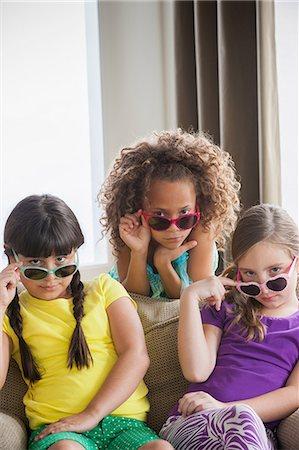 Portrait of three girls wearing sunglasses Stock Photo - Premium Royalty-Free, Code: 614-07146316