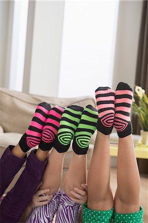 Three girls wearing brightly coloured socks Stock Photo - Premium Royalty-Free, Code: 614-07146327