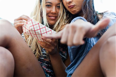 Friends eating takeaway food, Hermosa Beach, California, USA Stock Photo - Premium Royalty-Free, Code: 614-07146464