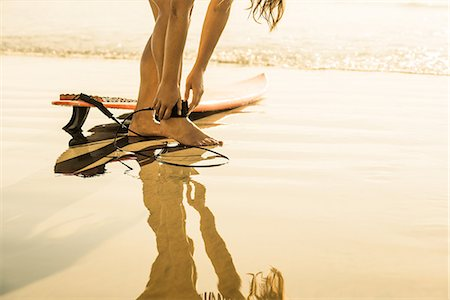 Young woman preparing to surf, La Jolla, San Diego, California, USA Stock Photo - Premium Royalty-Free, Code: 614-07146467