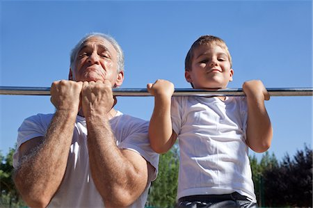 Man and grandson doing chin-ups Stock Photo - Premium Royalty-Free, Code: 614-07146500