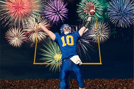 American football player celebrating with fireworks Stock Photo - Premium Royalty-Free, Code: 614-07146510