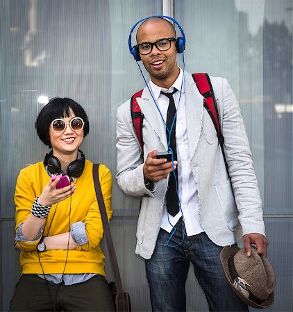 Young couple with mp3 players Stock Photo - Premium Royalty-Free, Code: 614-07146649