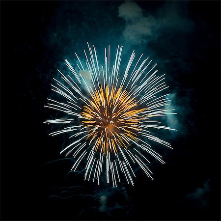 fireworks colored picture - Fireworks exploding in night sky Stock Photo - Premium Royalty-Free, Code: 614-07146686