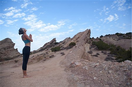 fitness   mature woman - Side view of woman doing yoga at Vazquez Rocks, LA Stock Photo - Premium Royalty-Free, Code: 614-07194333