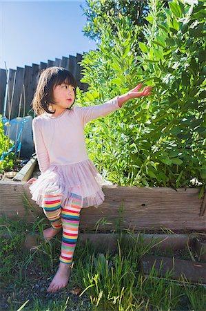 pantyhose kid - Girl in fava bean garden Stock Photo - Premium Royalty-Free, Code: 614-07194364