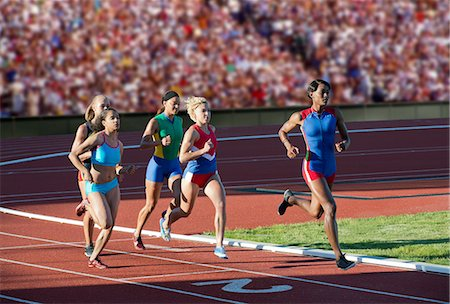 race track (people) - Runners racing on track Stock Photo - Premium Royalty-Free, Code: 614-07194374