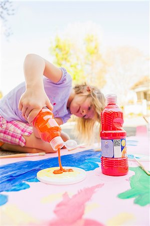 pouring paint art - Girl painting with tempera on paper Stock Photo - Premium Royalty-Free, Code: 614-07194372
