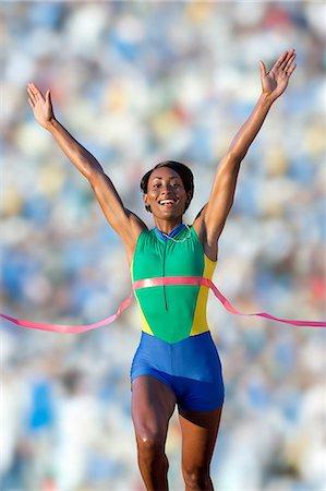 finish line - Runner at finish line Stock Photo - Premium Royalty-Free, Code: 614-07194384