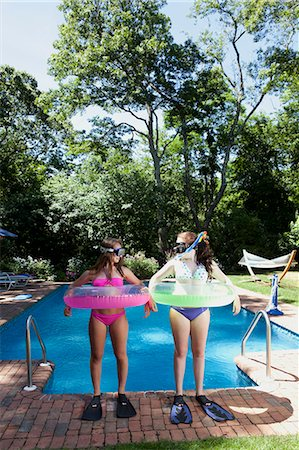 Friends playing by pool Stock Photo - Premium Royalty-Free, Code: 614-07194541