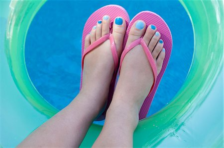 Overhead view of feet with colored nails Stock Photo - Premium Royalty-Free, Code: 614-07194559