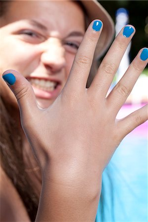 painted - Girl with painted finger nails Stock Photo - Premium Royalty-Free, Code: 614-07194550