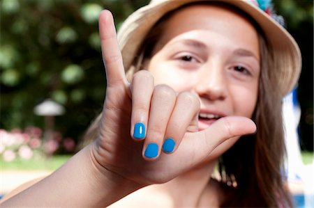 painted - Girl with painted finger nails Stock Photo - Premium Royalty-Free, Code: 614-07194551
