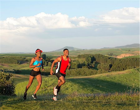 Young couple jogging in landscape, Othello, Washington, USA Stock Photo - Premium Royalty-Free, Code: 614-07194642