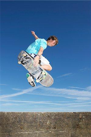 Teenage boy mid air on skateboard Stock Photo - Premium Royalty-Free, Code: 614-07194655