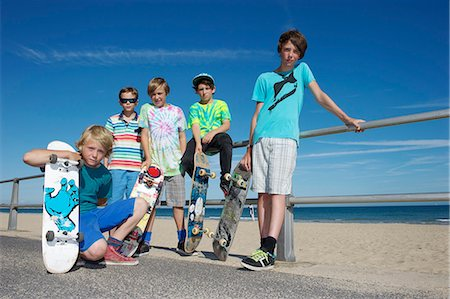 Portrait of five boys with skateboards at coast Stock Photo - Premium Royalty-Free, Code: 614-07194656