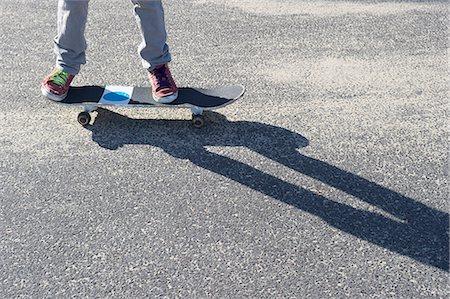 preteen feet - Detail of legs riding skateboard Stock Photo - Premium Royalty-Free, Code: 614-07194661