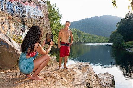 Young couple taking portrait on rock ledge, Hamburg, Pennsylvania, USA Stock Photo - Premium Royalty-Free, Code: 614-07194677