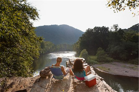 Young couple fishing on rock ledge, Hamburg, Pennsylvania, USA Stock Photo - Premium Royalty-Free, Code: 614-07194671