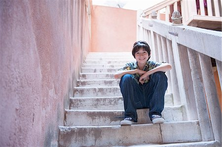 Boy sitting on steps Stock Photo - Premium Royalty-Free, Code: 614-07194701