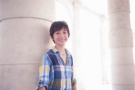 Portrait of boy wearing blue checked shirt Stock Photo - Premium Royalty-Free, Code: 614-07194702