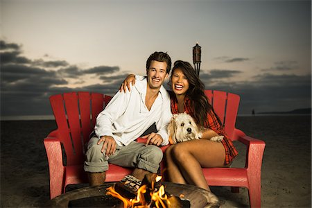 dog in heat - Young couple sitting by campfire on Mission Beach, San Diego, California, USA Stock Photo - Premium Royalty-Free, Code: 614-07194845