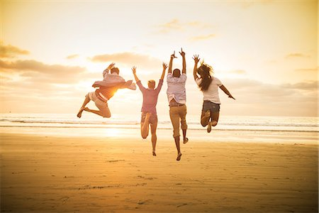 fun - Young people jumping on Mission Beach, San Diego, California, USA Stock Photo - Premium Royalty-Free, Code: 614-07194849