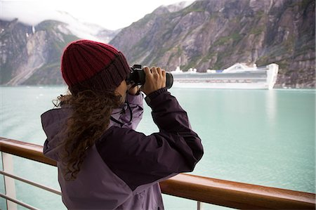 Woman using binoculars on cruise ship, Ketchikan, Alaska, USA Stock Photo - Premium Royalty-Free, Code: 614-07194881