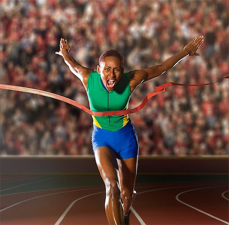 finish line - Young woman sprinting through winners tape in stadium Stock Photo - Premium Royalty-Free, Code: 614-07234797