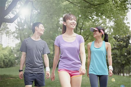 Three young joggers in park Stock Photo - Premium Royalty-Free, Code: 614-07234868