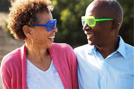 Senior couple wearing blue and green plastic glasses Stock Photo - Premium Royalty-Free, Code: 614-07234936