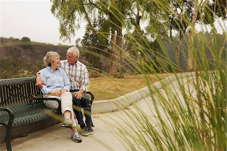 Husband and wife chatting lovingly on park bench Stock Photo - Premium Royalty-Free, Code: 614-07234962