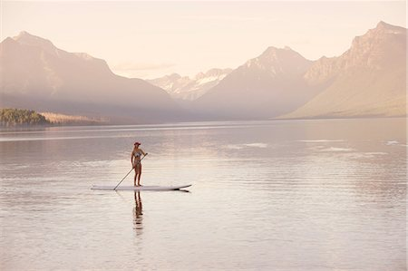 Woman on canoe, Lake McDonald, Glacier National Park, Montana, USA Stock Photo - Premium Royalty-Free, Code: 614-07239919