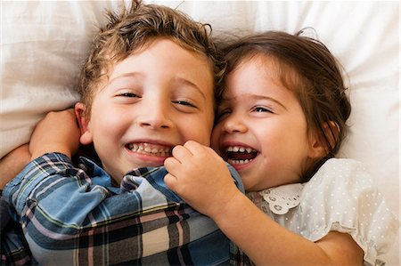 sister - Children lying on bed Stock Photo - Premium Royalty-Free, Code: 614-07239937