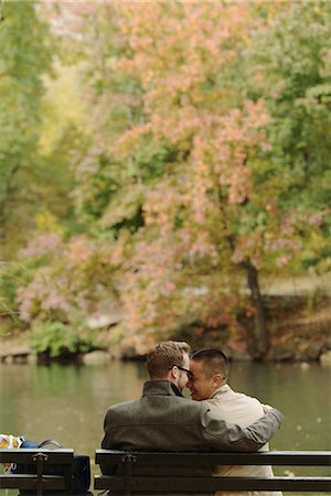 Gay couple hugging on park bench Stock Photo - Premium Royalty-Free, Code: 614-07239939