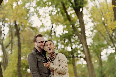 Gay couple hugging in park Stock Photo - Premium Royalty-Free, Code: 614-07239944